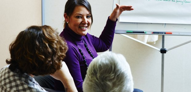 Three people taking part in a workshop