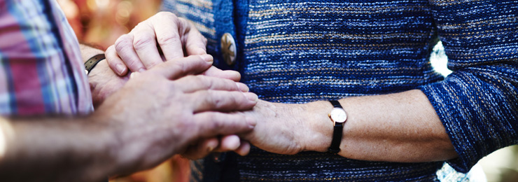 Close up of a man and woman holding hands